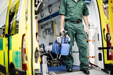 Paramedics at work with an ambulance