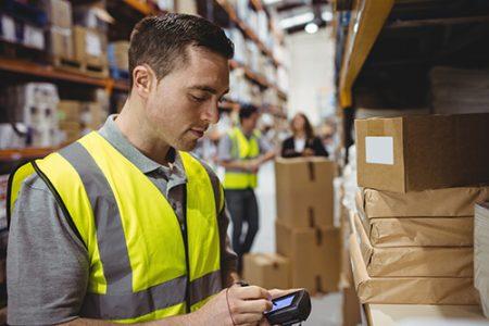 warehouse worker using handheld scanner