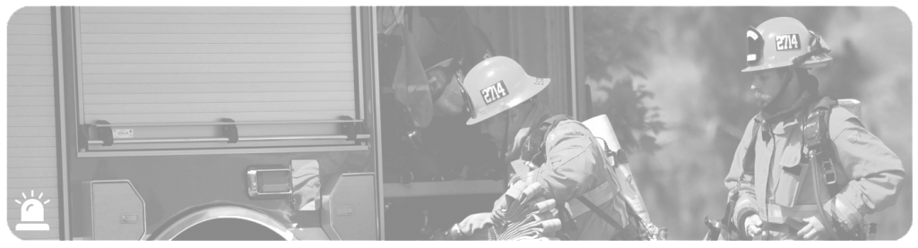 greyscale fire fighters loading fire engine